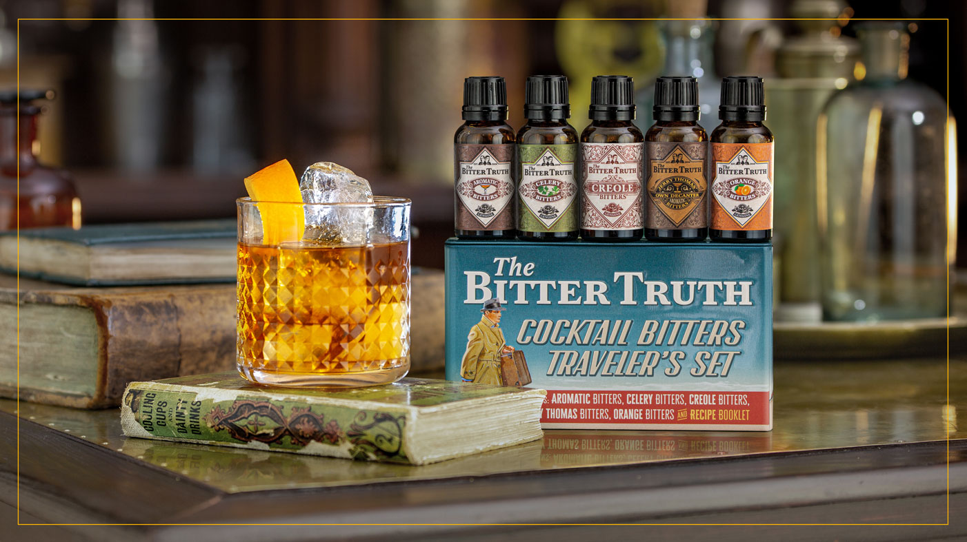 Cocktail Bitters Traveler`s Set with drink and book