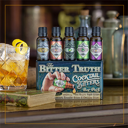 The Bitter Truth Bitters Bar Pack on shelf with drink