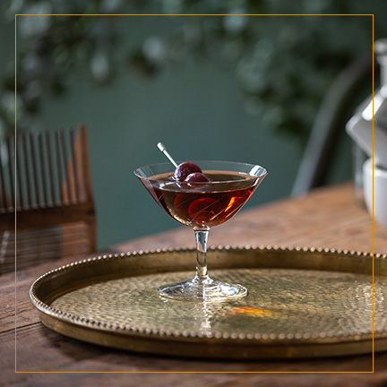 Manhattan Cocktail on brass plate