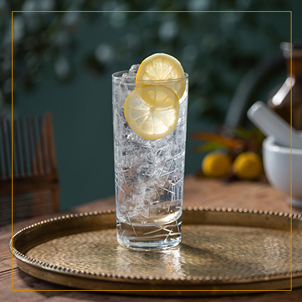 Gin and Tonic on brass plate