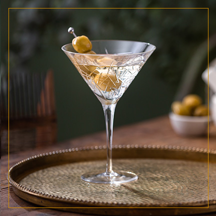 Dirty Martini with olives on brass plate