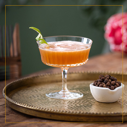 Lions Tail Cocktail on brass plate with spices